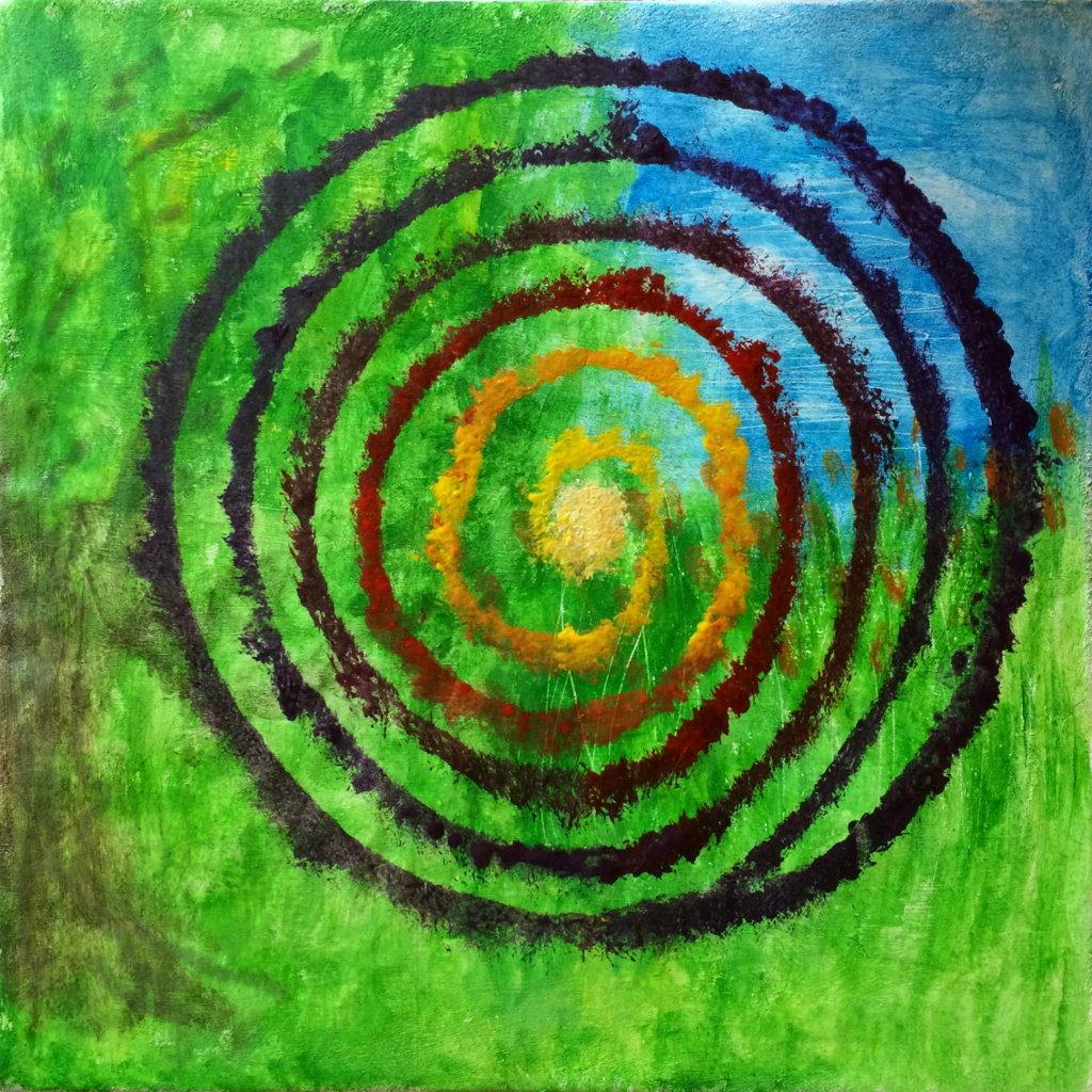 Eine bunte, rechts drehende Spirale vor grün-blauem Hintergrund.